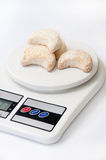 Rolls with coconut on a kitchen scale Royalty Free Stock Photos