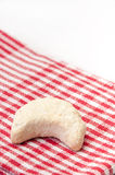 Rolls with coconut on the red kitchen sheet Stock Image