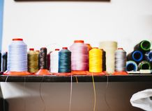 Rolls of colored cotton thread for sewing with machine. In store Royalty Free Stock Photo