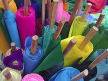 Rolls of colored fabric Stock Images