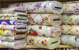 Rolls of colored fabrics. Textile background Stock Photo