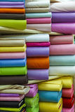 Rolls of colored fabrics. Textile background Stock Image