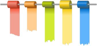 Rolls of colored papers at metal rod Stock Photography