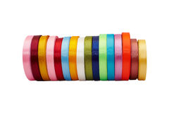 Rolls of colored satin ribbons Stock Photo