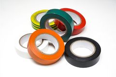 Rolls of colored tapes. Some rolls of colored insulating tapes on a white surface royalty free stock images