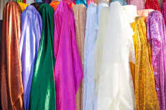 Rolls colorful of brightly coloured fabrics and cloths store. A Rolls colorful of brightly coloured fabrics and cloths store Stock Photos