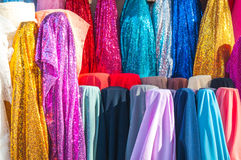 Rolls colorful of brightly coloured fabrics and cloths store. A Rolls colorful of brightly coloured fabrics and cloths store Stock Images