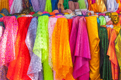 Rolls colorful of brightly coloured fabrics and cloths store. A Rolls colorful of brightly coloured fabrics and cloths store Royalty Free Stock Photo