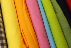 Rolls of colorful cloth for sale. By the merchant of fine fabrics Royalty Free Stock Photos
