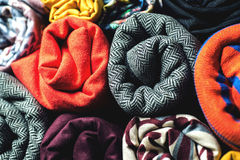 Rolls of colorful fabric as a vibrant background Stock Image
