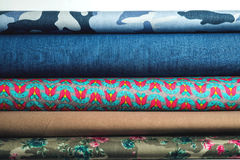 Rolls of colorful fabric as a vibrant background Stock Images