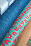 Rolls of colorful fabric as a vibrant background Royalty Free Stock Image