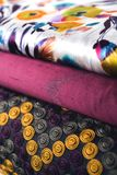 Rolls of colorful fabric as a vibrant background Royalty Free Stock Photos