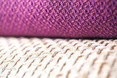 Rolls of colorful fabric as a vibrant background Stock Photo