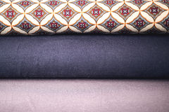 Rolls of colorful fabric as a vibrant background Stock Photos