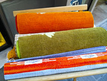 Rolls of colorful fabric Stock Images