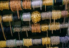 Rolls of colorful metal chains as a background. Rolls of  metal chains as a background texture stock image