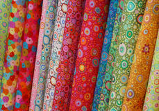 Rolls of colorful printed cloths. Close up of colorful printed rolls of cloth, horizontal format Royalty Free Stock Photos