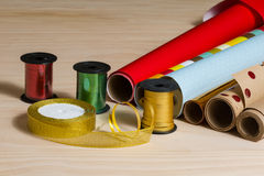 Rolls of colorful wrapping paper and ribbon Royalty Free Stock Photography