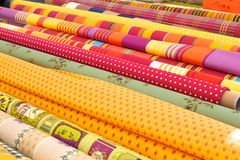 Rolls of colourful fabric. Rolls of fabric on a Provence Market stall stock image