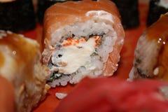 Rolls con i salmoni Immagine Stock