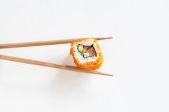 Rolls con los salmones y el aguacate Fotos de archivo libres de regalías