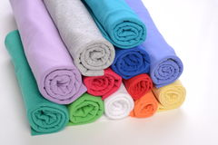 Rolls of cotton cloth with different color. Royalty Free Stock Photography