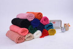 Rolls of cotton scarfs with different colors Royalty Free Stock Photos