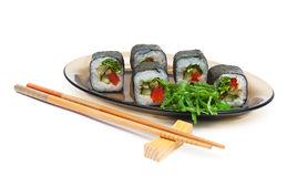 Rolls with cucumber and pepper on a plate on a white background Royalty Free Stock Photos
