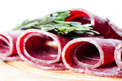 Rolls of cured smoked beef Stock Image