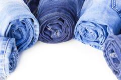 Rolls da calças de ganga isolada no fundo branco fotos de stock royalty free