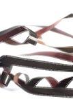 Rolls de film embrouillé de 35mm au-dessus de blanc Photographie stock libre de droits