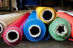 Rolls de tissu au marché Photos stock