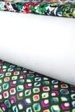 Rolls de tissu coloré comme fond vibrant photo libre de droits