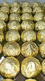 Rolls degli involucri dorati della stagnola Fotografia Stock