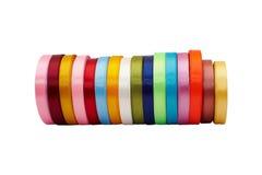 Rolls dei nastri colorati del raso Fotografia Stock