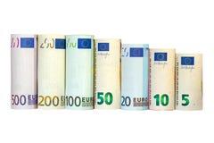 Rolls del billete de banco euro Diverso dinero europeo aislado en whi Fotografía de archivo libre de regalías
