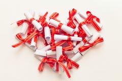 Rolls del papel atado con la cinta roja Fotografía de archivo