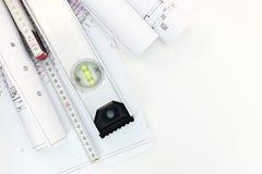 Rolls del papel de dibujo con planes y proyectos de la ocupación del terreno Archite Foto de archivo libre de regalías