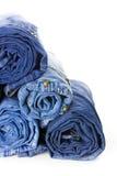 Rolls der Blue Jeans getrennt auf weißem Hintergrund Lizenzfreie Stockbilder