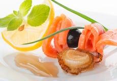 Rolls des poissons rouges avec le citron Photographie stock libre de droits