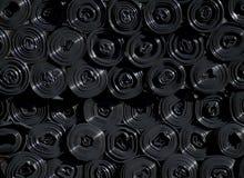 Rolls des sacs en plastique noirs Photographie stock libre de droits