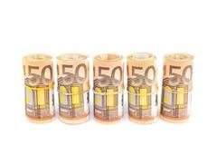Rolls di euro fatture nella fila su bianco Fotografia Stock Libera da Diritti