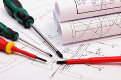 Rolls of diagrams and work tools on electrical construction drawing of house Royalty Free Stock Photos