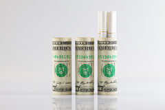 Rolls of dollar bills and a long cigarettes Royalty Free Stock Photos