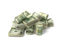Rolls of dollars and stacks of bills Royalty Free Stock Images