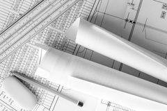 Rolls of drawings with the pencil and eraser on the scheme Royalty Free Stock Photos