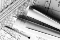 Rolls of drawings with the pencil and slide rule Royalty Free Stock Photo