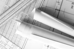 Rolls of drawings and slide rule on the scheme Royalty Free Stock Photo
