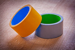 Rolls of duct tape on vintage brown wood board Royalty Free Stock Photos